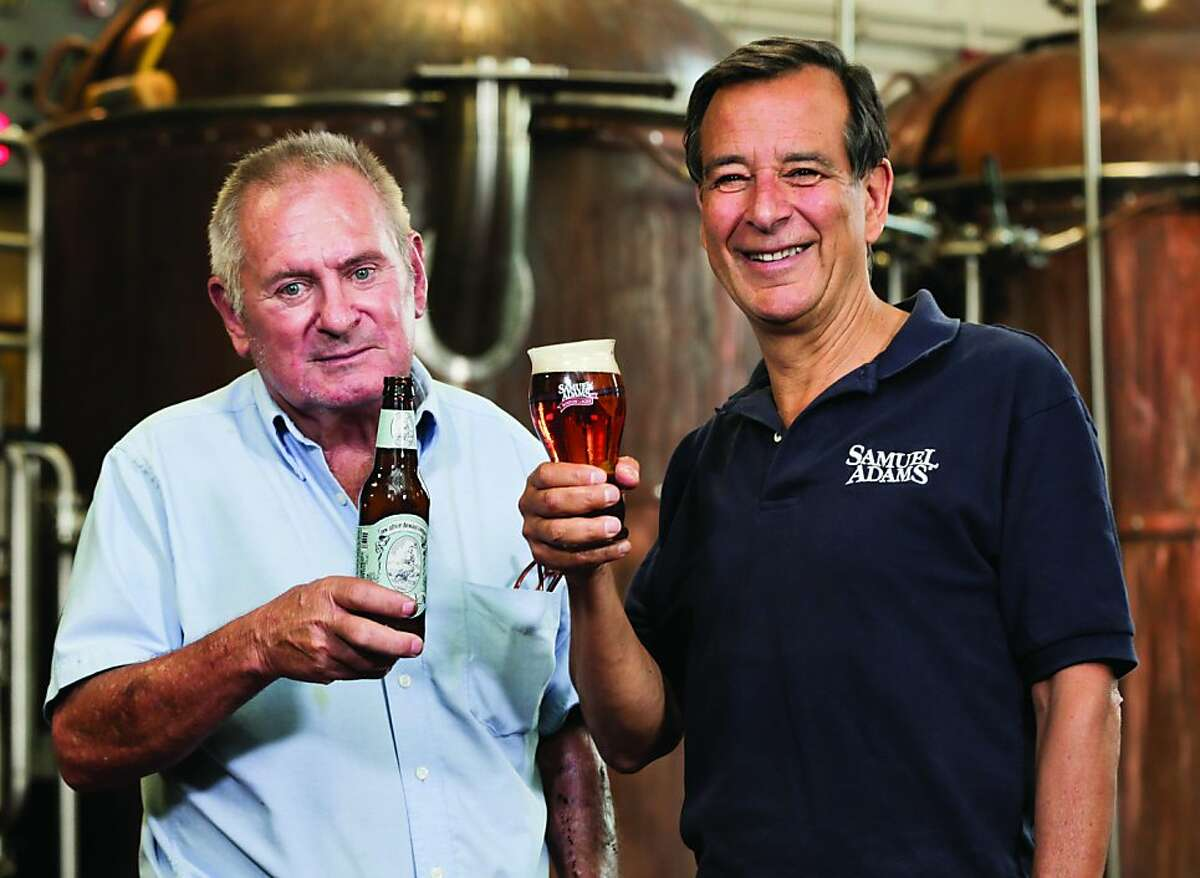 Jack McAuliffe, brewer of New Albion ale, and Jim Koch, founder and brewer of Samuel Adams, raise a pint after the first batch of New Albion ale was brewed by Jack for the first time in 30 years.