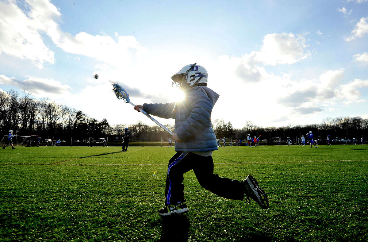 Seven-year-old Ryan Dahlquist tosses a ball around during youth lacrosse practice at Darien High School on Tuesday, April 2, 2013. Darien is considered to have the youngest average population among towns in southwestern Connecticut. People say one of the factors in raising children in Darien is the vibrant youth sports community.