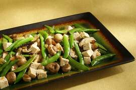 Tofu with mushrooms & snap peas as seen in San Francisco, California on Wednesday, March 27, 2013. Food styled by Lynne Bennett.