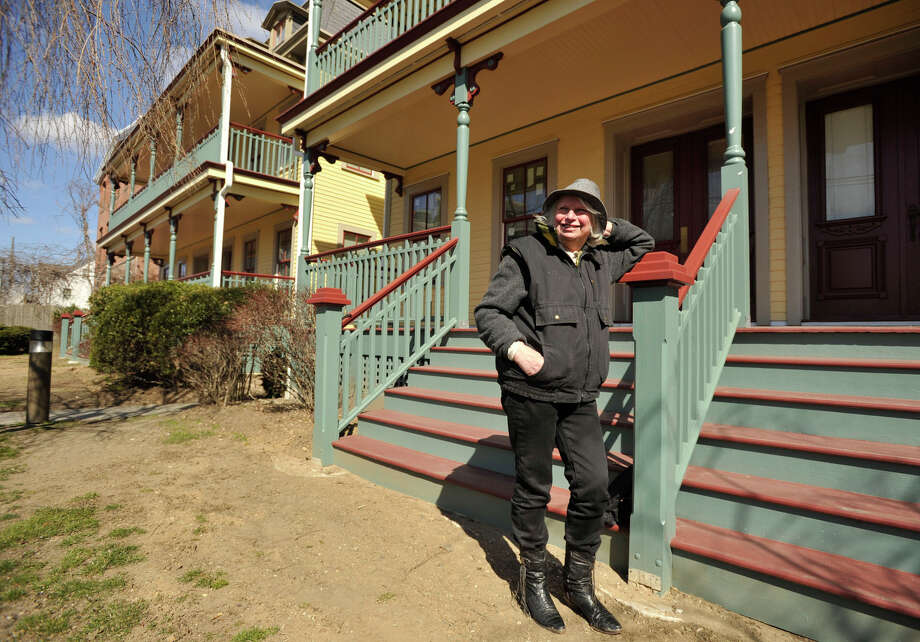 "Renee Kahn poses in front of Atlantic Park Apartments on Atlantic Street in Stamford on Wednesday, April 3, 2013. Kahn will be receiving the Janet Jainschigg Award for Excellence in Historic Preservation from the Connecticut Trust for Historic Preservation. Kahn was one of the individuals instrumental in the overall renovations of the Atlantic Park Apartments. Surveying the property she said, ""This is the best it's ever looked."" Photo: Jason Rearick / The (Stamford) Advocate"