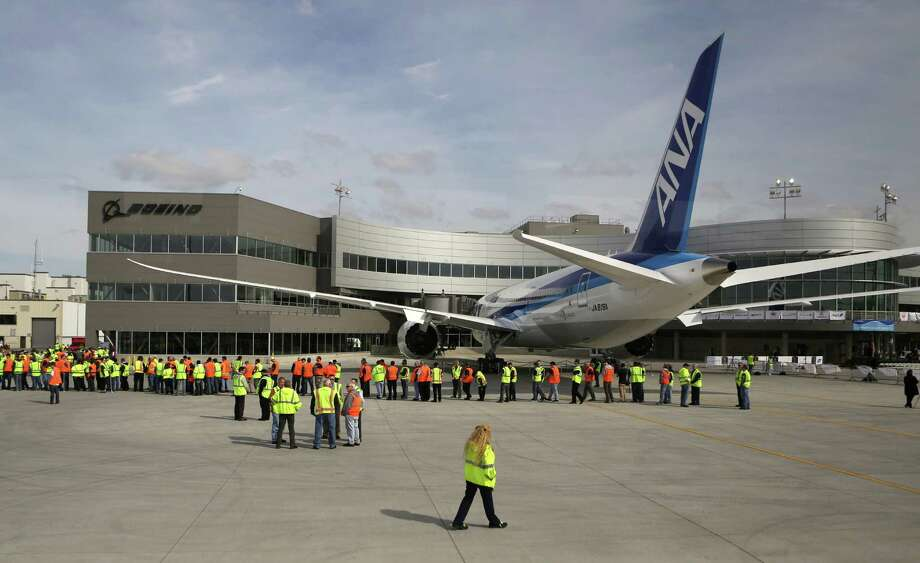 Workers gather during a ceremony opening Boeing's new Everett Delivery Center on Wednesday, April 3, 2013 at Paine Field. The facility is where airplane customers will take ownership of their airplanes. Photo: JOSHUA TRUJILLO / SEATTLEPI.COM