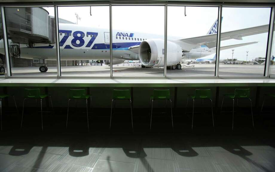 An All Nippon Airways 787 is shown through a window of the cafeteria of Boeing's new Everett Delivery Center. Photo: JOSHUA TRUJILLO / SEATTLEPI.COM