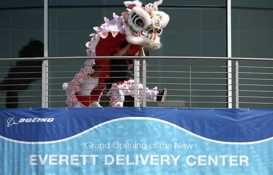 A lion dancer performs during a ceremony opening Boeing's new Everett Delivery Center. Photo: JOSHUA TRUJILLO / SEATTLEPI.COM