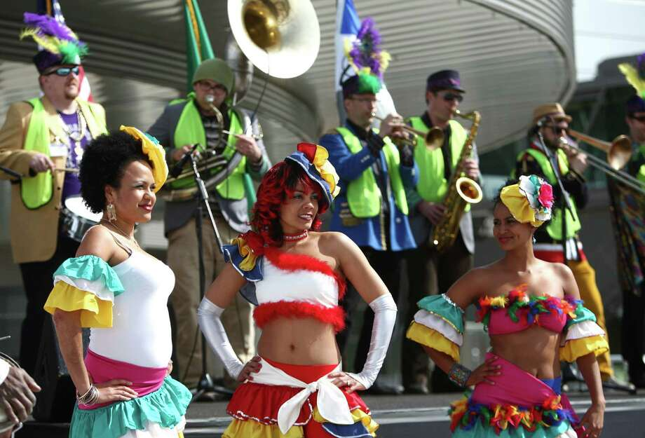 Caribbean dancers perform as music and dance groups from various nations that purchase Boeing aircraft perform during a ceremony opening Boeing's new Everett Delivery Center. Photo: JOSHUA TRUJILLO / SEATTLEPI.COM
