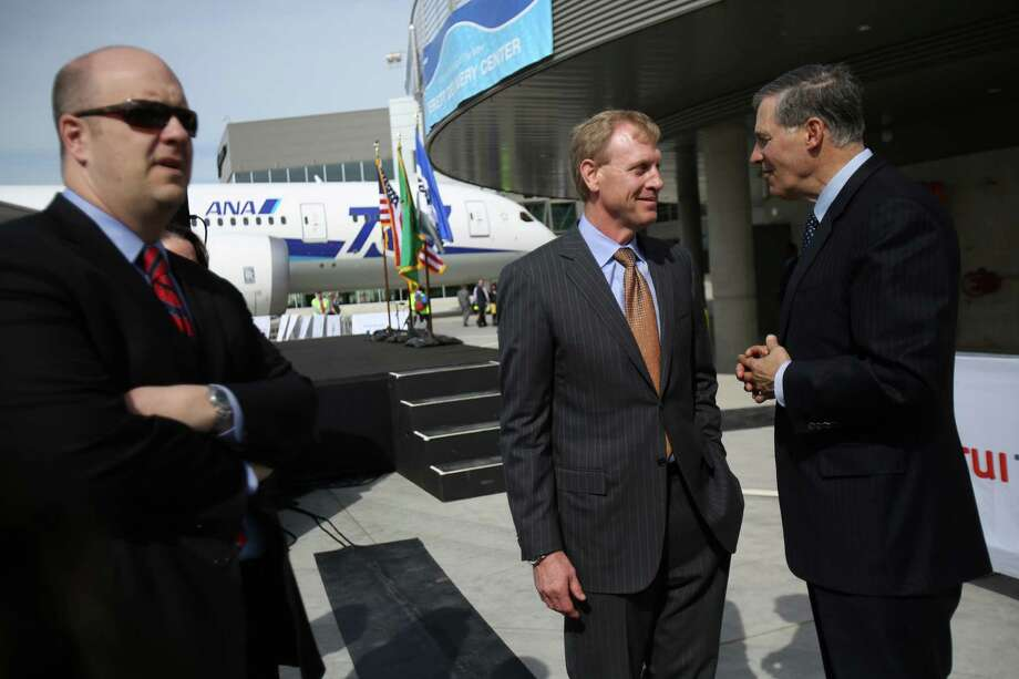Washington Governor Jay Inslee, right, and Pat Shanahan, vice president and general manager of Airplane Programs for Boeing Commercial Airplanes, speak during a ceremony opening Boeing's new Everett Delivery Center. Photo: JOSHUA TRUJILLO / SEATTLEPI.COM