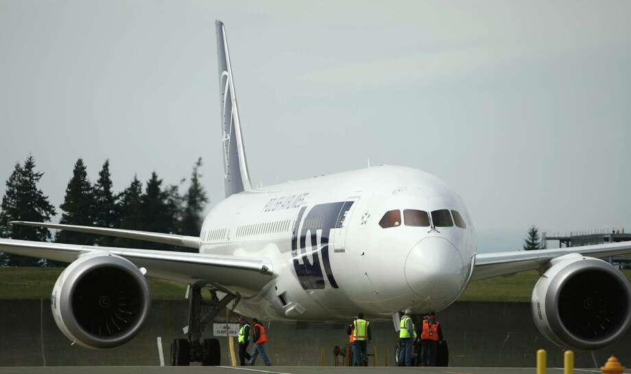 A Boeing 787 built for Polish Airlines prepares to taxi for a test flight as seen during a ceremony opening Boeing's new Everett Delivery Center on Wednesday, April 3, 2013 at Paine Field. The plane is part of a program testing components after Boeing encountered serious problems with the 787's lithium-ion battery. The risk of fire from the battery grounded the entire fleet. Photo: JOSHUA TRUJILLO / SEATTLEPI.COM