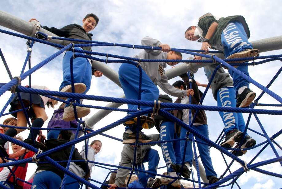 No. 30: Norwalkhas the lowest percentage of residents under the age of 18 in all of Southwestern Connecticut, at 19.7 percent.   Students climb on the jungle gym in the new playground at All Saints Catholic School in Norwalk, Conn. on Monday November 28, 2011 before the arrival of Bishop Lori of the Diocese of Bridgeport who came to bless the playground.
