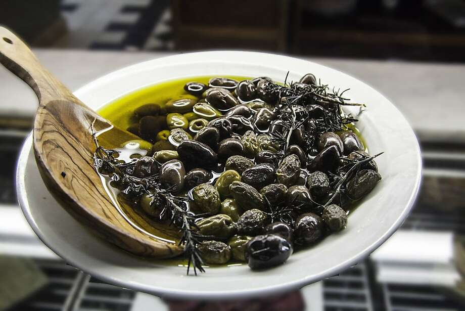 Olive oil, and olives, are components of the popular Mediterranean diet, which has received renewed study lately by health professionals Photo: Steve Haggerty, McClatchy-Tribune News Service