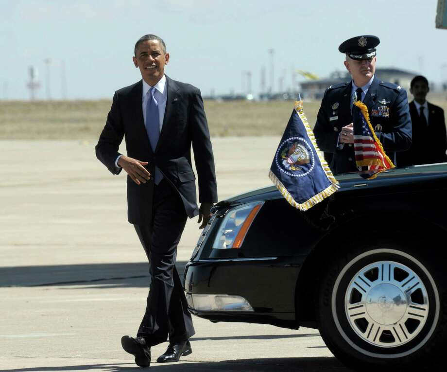 President Barack Obama walks to greet people after arriving at Buckley Air Force Base in Colo.,Wednesday, April 3, 2013. Obama is meeting with local law enforcement officials and community leaders to discuss the state's new measures to reduce gun violence. (AP Photo/Susan Walsh) Photo: Susan Walsh