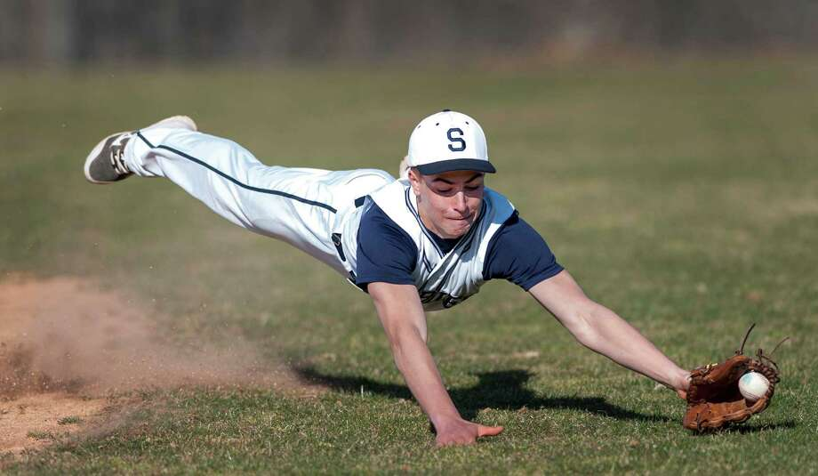 Staples High School's second baseman Zachary Azadian dives to stop a ball from getting to the outfield in the season opening baseball game against Newtown High School played at Staples High School, Westport, CT on Wednesday April 3rd, 2013. Photo: Mark Conrad / Connecticut Post Freelance