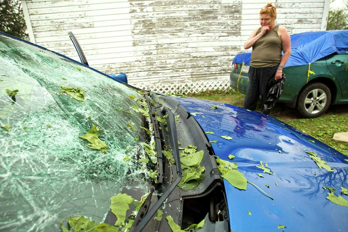 The path of late Tuesday's hailstorm could be traced Wednesday morning by the damage done to cars like Derinda Norred's.