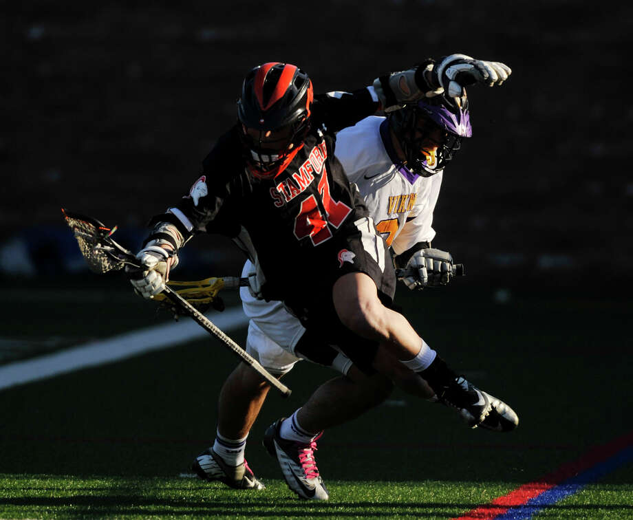 Westhill's Evan Skoparantzos collides with Stamford's Andrew Kydes during their game at Westhill High School in Stamford on Wednesday, April 3, 2013. Stamford beat Westhill, 13-7. Photo: Jason Rearick / The (Stamford) Advocate