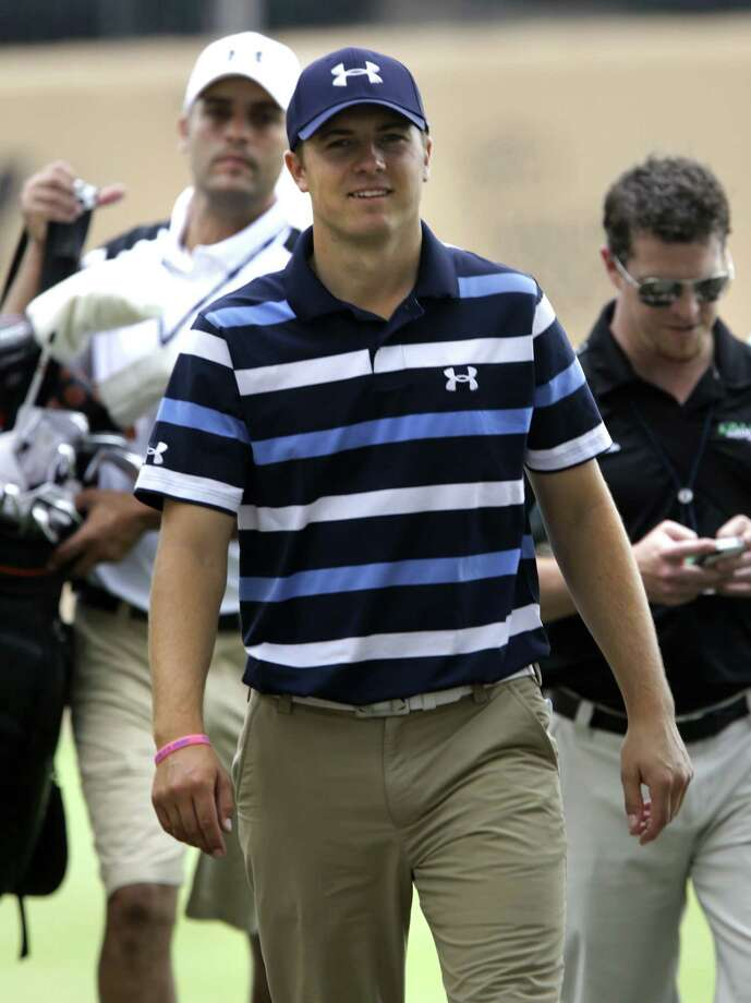 Jordan Spieth (left) will play with Rory McIlroy today.