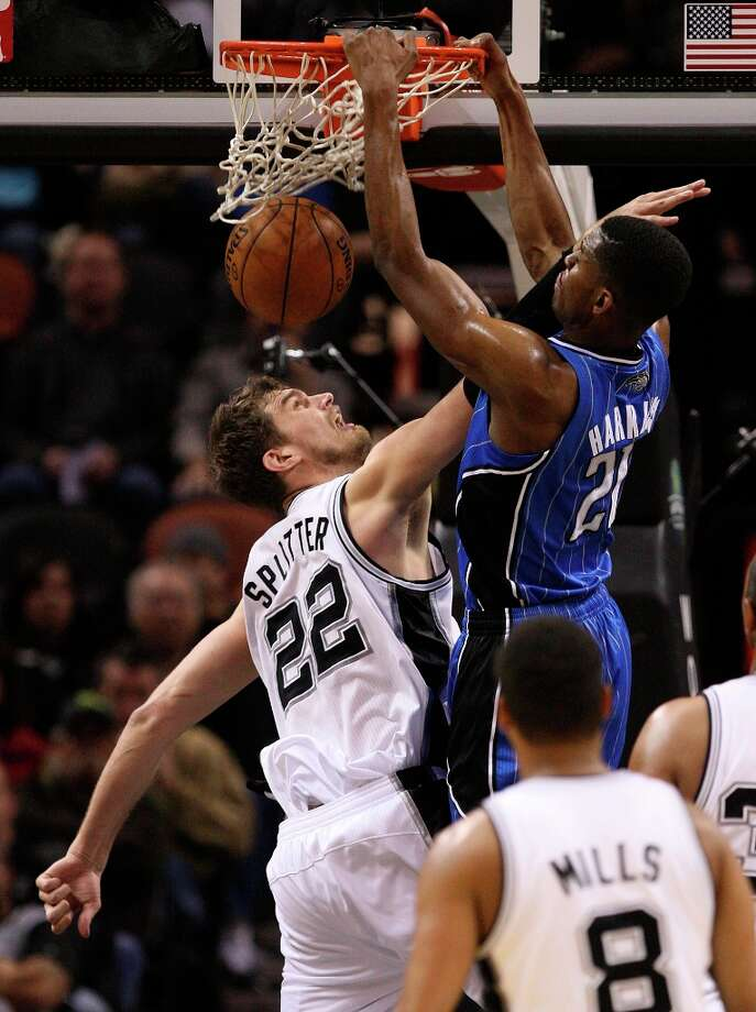 Orlando Magic\'s Maurice Harkless dunks over the Spurs\' Tiago Splitter during the first half at the AT&T Center, Wednesday, April 3, 3013. Photo: Jerry Lara, San Antonio Express-News / ©2013 San Antonio Express-News