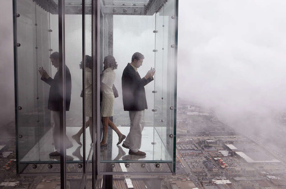 ...Chicagoans get to pay a dollar less for a similar ride up the Willis Tower (pictured). And they get to go higher (to 1,353 feet) and stand in a neato, glass viewing box. Photo: Scott Olson, Getty Images / 2009 Getty Images