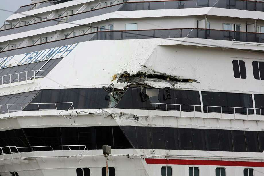 The Carnival cruise ship Triumph rests against a dock after it tore loose from its mooring Wednesday at the BAE Shipyard in Mobile, Ala. The ship sustained a 20-foot gash when it struck a cargo vessel. Photo: Bill Starling, MBI / AL.com