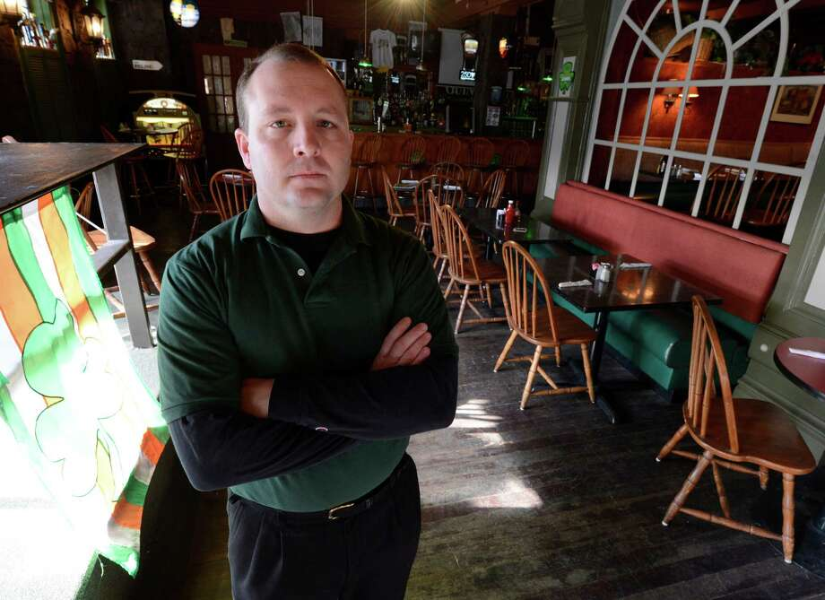 """Don Russell, shown at Irish Mist, the First Street bar and restaurant he owns, is among those objecting to a proposal that would allow adult business along the waterfront in South Troy. """"People are just up in arms over this thing,"""" he said. (Skip Dickstein/Times Union) Photo: SKIP DICKSTEIN / 10021825A"""