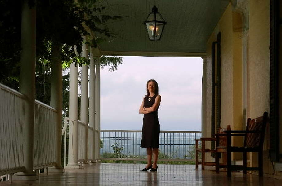 Elizabeth Jacks, executive director of the Thomas Cole National Historic Site, stands on the front porch of the house in Catskill. (Times Union archive)