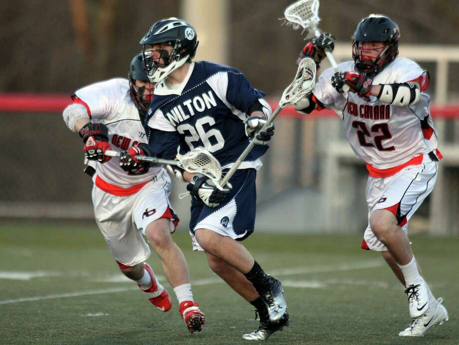 Wilton senior middie Thomas Hayes runs by a pair of New Canaan defenders during first half FCIAC action in New Canaan. © J. Gregory Raymond for The Advocate Photo: J. Gregory Raymond / Stamford Advocate Freelance;  © J. Gregory Raymond