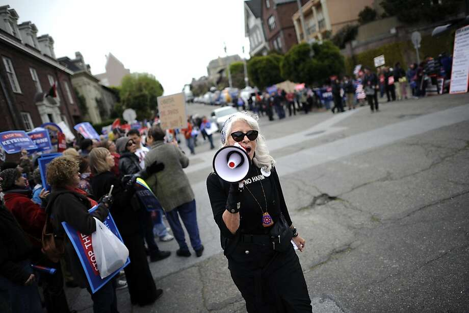 Janine Boneparth of Sausalito uses a megaphone to get the gathered crowds fired up.  Protestors gathered in San Francisco, CA Wednesday April 3rd, 2013 to voice their opposition to the Keystone XL Pipeline during a visit by President Obama. Photo: Michael Short, Special To The Chronicle
