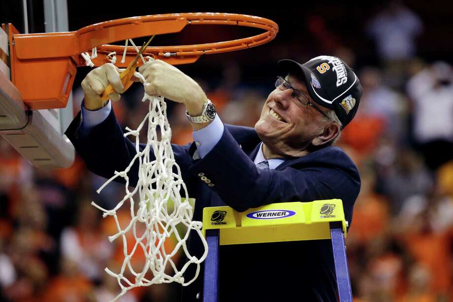 Syracuse head coach Jim Boeheim cuts down the net following their 55-39 win over Marquette in the East Regional final in the NCAA men's college basketball tournament, Saturday, March 30, 2013, in Washington. (AP Photo/Pablo Martinez Monsivais) Photo: Pablo Martinez Monsivais