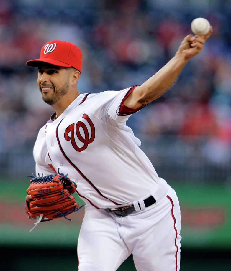 Washington Nationals starting pitcher Gio Gonzalez throws during the first inning of a baseball game against the Miami Marlins at Nationals Park on Wednesday, April 3, 2013, in Washington. (AP Photo/Alex Brandon) Photo: Alex Brandon