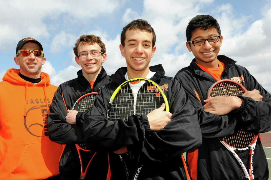 Coach Steve Smith, left, poses with tennis players Nick Mashuta, second from left, Nick DeLuke, center, and Rohin Bose on Tuesday, April 2, 2013, at Bethlehem High in Delmar, N.Y. (Cindy Schultz / Times Union) Photo: Cindy Schultz / 10021807A