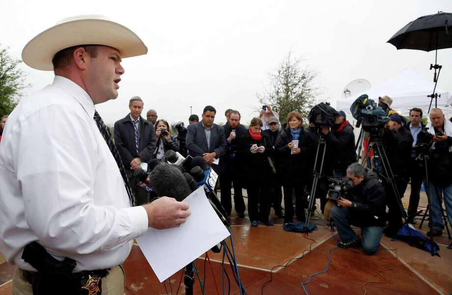 Justin Lewis, PIO of Kaufman County Sheriff's office, left, confirmed the arrest of Nick Morale, 56, of Terrell, Texas on Wednesday, April 3, 2013 at a brief news conference at the Kaufman County Law Enforcement Center. (AP Photo/The Dallas Morning News, David Woo) Photo: David Woo, MBR / The Dallas Morning News