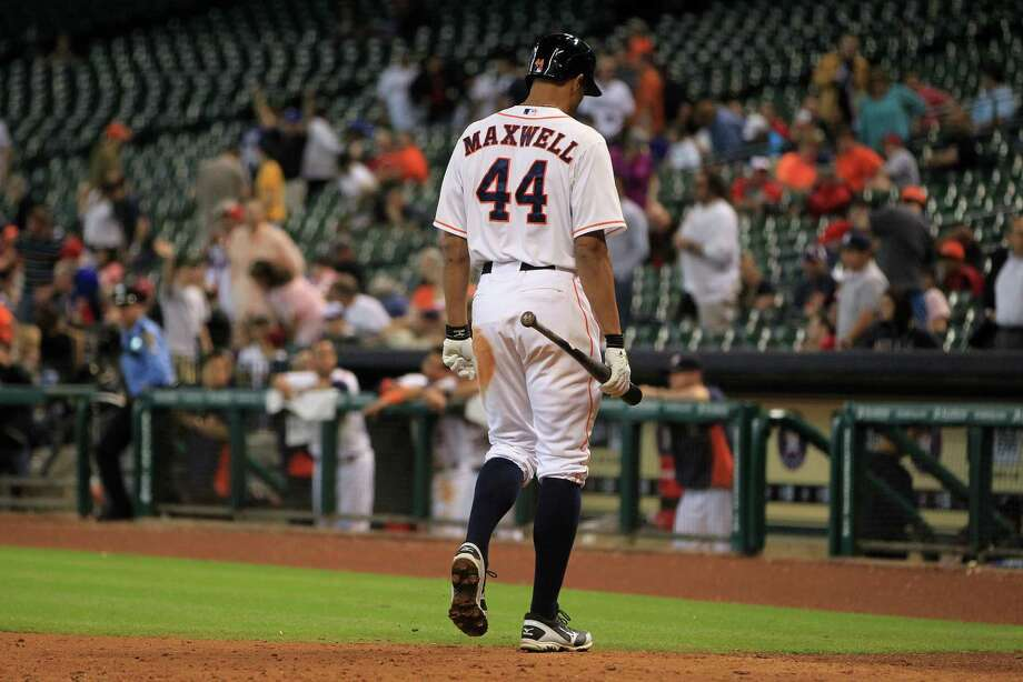 In a fitting conclusion to Wednesday's game, Justin Maxwell heads to the dugout after striking out against Joe Nathan. Photo: Karen Warren, Staff / © 2013 Houston Chronicle