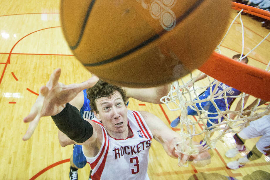 April 1: Rockets 111, Magic 103 Rockets center Omer Asik had career high 22 points along with 18 rebounds during a 111-103 victory over the Orlando Magic. Photo: Smiley N. Pool, Houston Chronicle / © 2013  Houston Chronicle