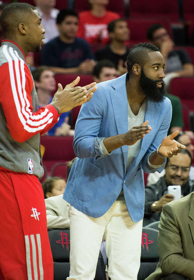 Rockets shooting guard James Harden cheers from the sidelines. Harden sat out for the second straight game with a sore foot. Photo: Smiley N. Pool, Houston Chronicle / © 2013  Houston Chronicle