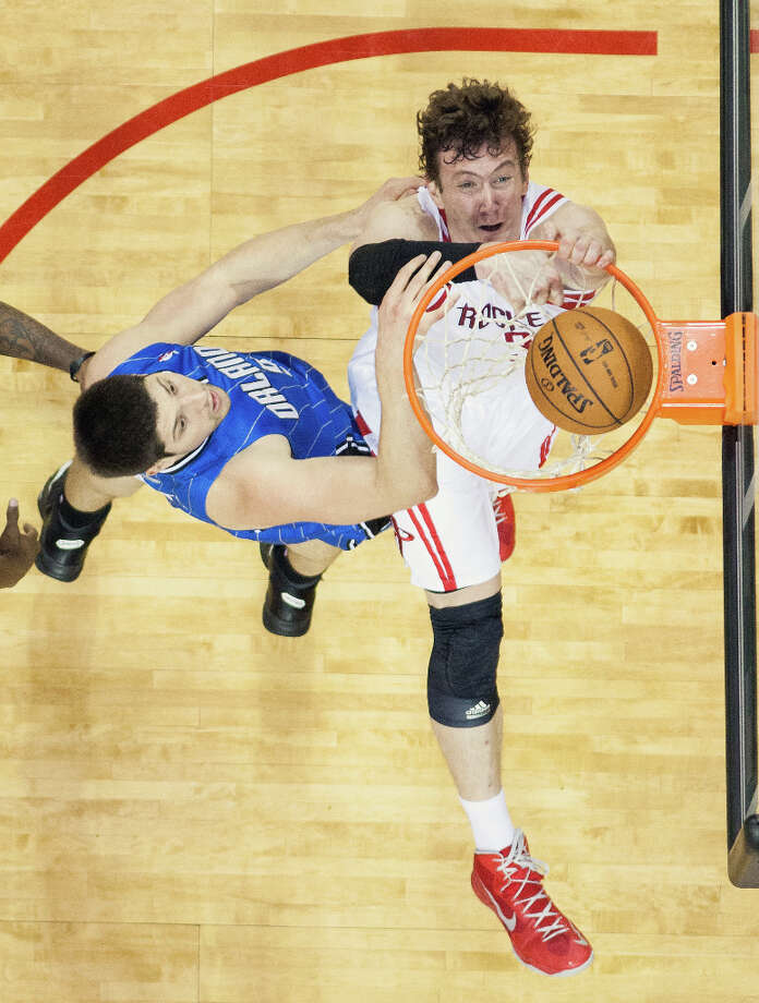 Rockets center Omer Asik dunks the ball over Magic center Nikola Vucevic. Photo: Smiley N. Pool, Houston Chronicle / © 2013  Houston Chronicle