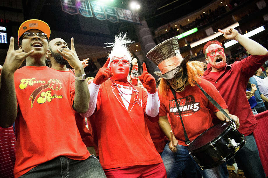 The Red Rowdies cheer the Rockets on against the Orlando Magic. Photo: Smiley N. Pool, Houston Chronicle / © 2013  Houston Chronicle