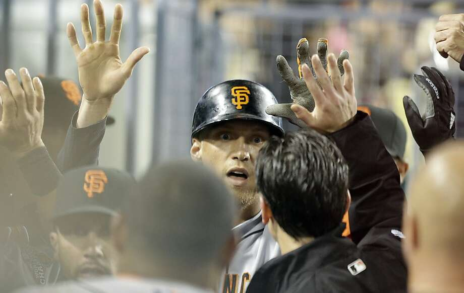 Hunter Pence is congratulated by San Francisco Giants teammates after his solo home run against the Los Angeles Dodgers in the sixth inning of a baseball game in Los Angeles Wednesday, April 3, 2013. (AP Photo/Reed Saxon) Photo: Reed Saxon, Associated Press