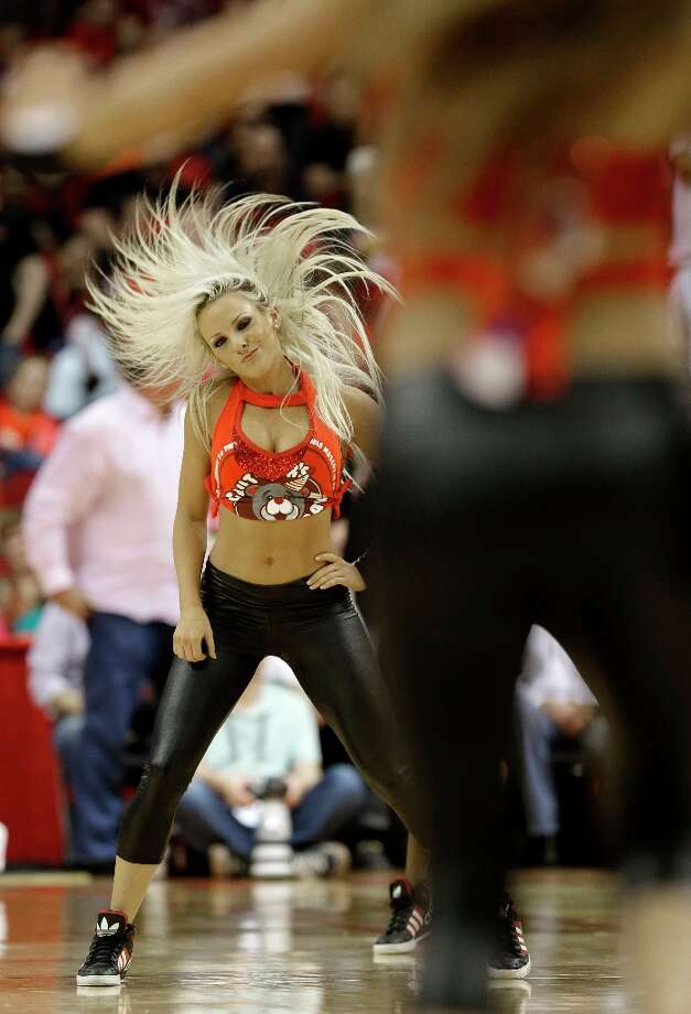 2984 x 4376~~$~~A Houston Rockets dancer works a routine in the second half of an NBA basketball game against the Minnesota Timberwolves Friday, March 15, 2013, in Houston. The Rockets won 108-100. Photo: Pat Sullivan