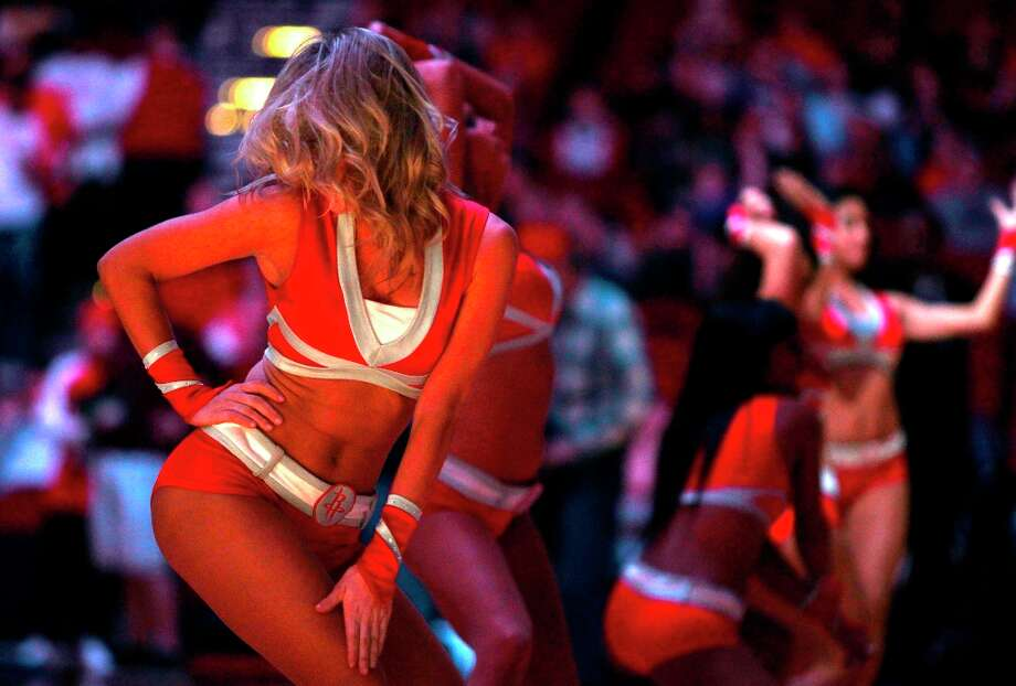 A member of the Houston Rockets Power Dancers performs before the start of the Houston Rockets match-up with the Washington Wizards at Toyota Center. Wednesday, Dec. 12, 2012, in Houston Photo: Billy Smith II / © 2013 Houston Chronicle