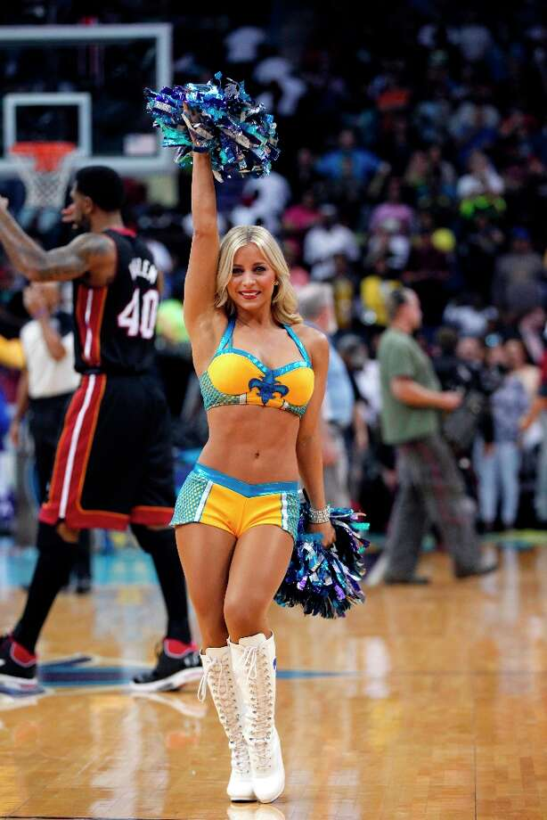 3264 x 4896~~$~~New Orleans Hornets Honeybee cheerleader performs in the first half of an NBA basketball game in New Orleans, Friday, March 29, 2013. Photo: Gerald Herbert