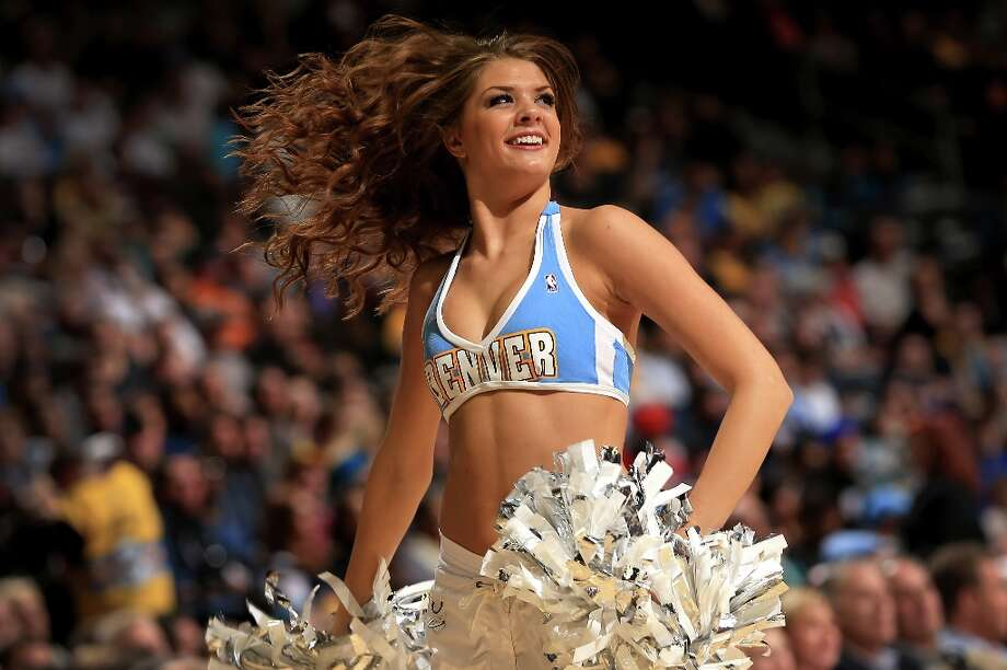 4000 x 2660~~$~~DENVER, CO - MARCH 04:  A member of the Denver Nuggets Dance Team performs during a break in the action against the Atlanta Hawks at the Pepsi Center on March 4, 2013 in Denver, Colorado. The Nuggets defeated the Hawks 104-88. NOTE TO USER: User expressly acknowledges and agrees that, by downloading and or using this photograph, User is consenting to the terms and conditions of the Getty Images License Agreement. Photo: Doug Pensinger / 2013 Getty Images