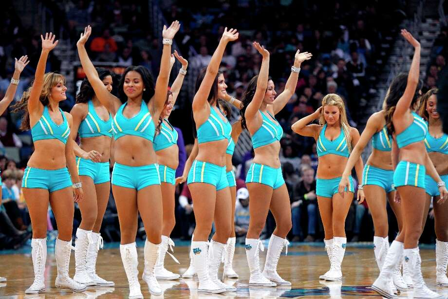 4896 x 3264~~$~~New Orleans Hornets Honeybee cheerleaders perform in the second half of an NBA basketball game against the Los Angeles Clippers in New Orleans, Wednesday, March 27, 2013. The Clippers won 105-91. Photo: Gerald Herbert
