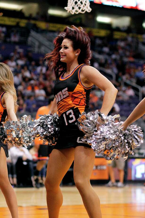 1800 x 2700~~$~~A Phoenix Suns cheerleader performs during a timeout against the Indiana Pacers during an NBA basketball game Saturday, March 30, 21013, in Phoenix. Photo: Paul Connors