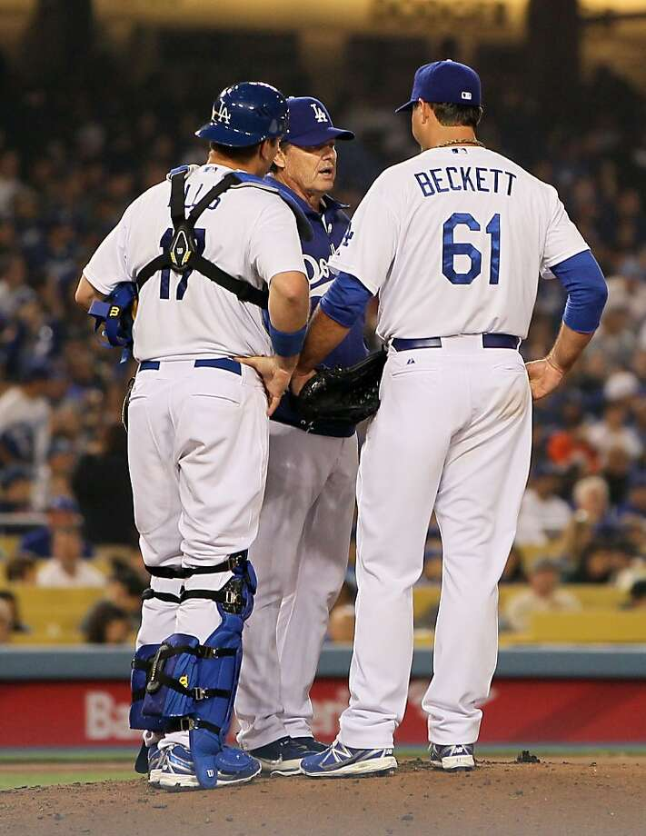 LOS ANGELES, CA - APRIL 03:  Pitching coach Rick Honeycutt of the Los Angeles Dodgers visits the mound to talk to pitcher Josh Beckett #61 as catcher A.J. Ellis #17 looks on during the MLB game against the San Francisco Giants in the fourth inning at Dodger Stadium on April 3, 2013 in Los Angeles, California.  (Photo by Victor Decolongon/Getty Images) Photo: Victor Decolongon, Getty Images