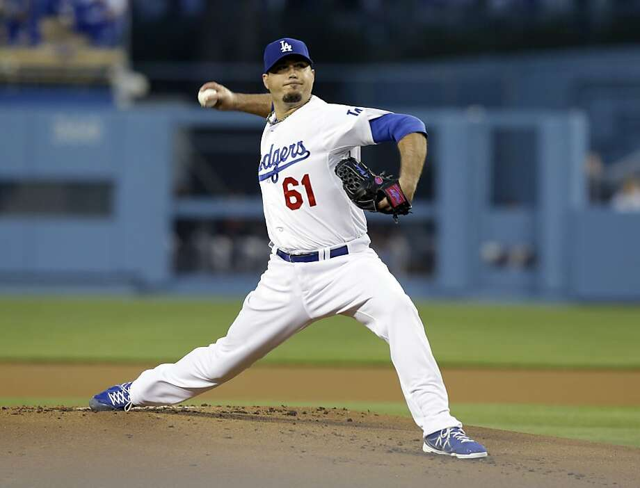 Los Angeles Dodgers starter Josh Beckett pitches to the San Francisco Giants in the first inning of a baseball game in Los Angeles, Wednesday, April 3, 2013. (AP Photo/Reed Saxon) Photo: Reed Saxon, Associated Press