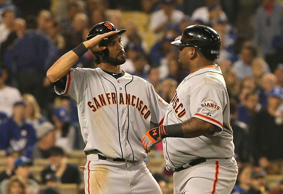 LOS ANGELES, CA - APRIL 03:  Pablo Sandoval #48 of the San Francisco Giants (R) celebrates with teammate Angel Pagan #16 after Sandoval hit a two-run home run in the third inning against pitcher Josh Beckett #61 of the Los Angeles Dodgers (not in photo) during the MLB game at Dodger Stadium on April 3, 2013 in Los Angeles, California.  (Photo by Victor Decolongon/Getty Images) Photo: Victor Decolongon, Getty Images