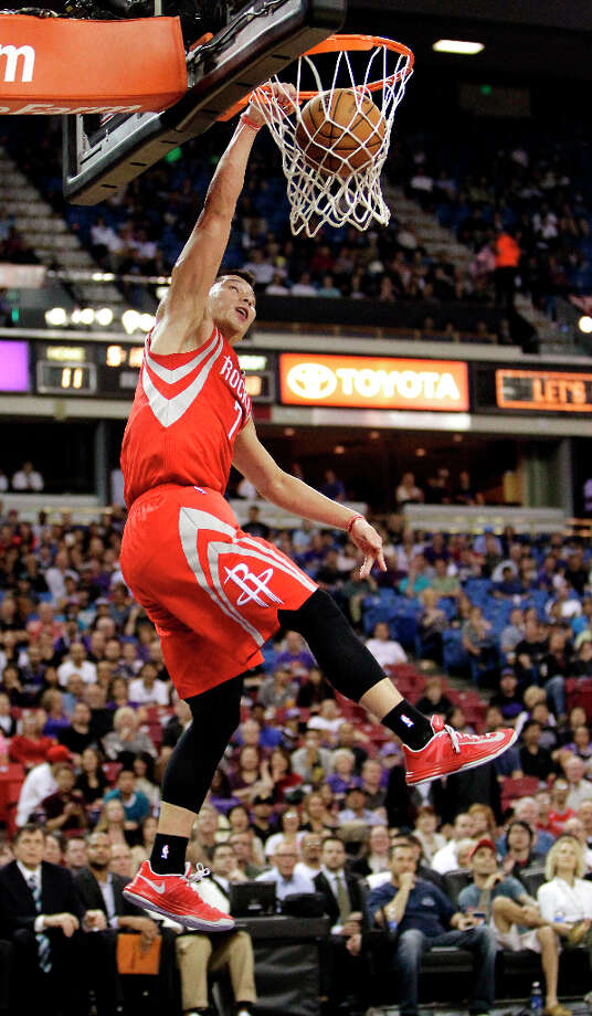 April 3: Rockets 112, Kings 102 Rockets point guard Jeremy Lin dunks in two points during the first quarter against the Kings. Photo: Rich Pedroncelli, Associated Press