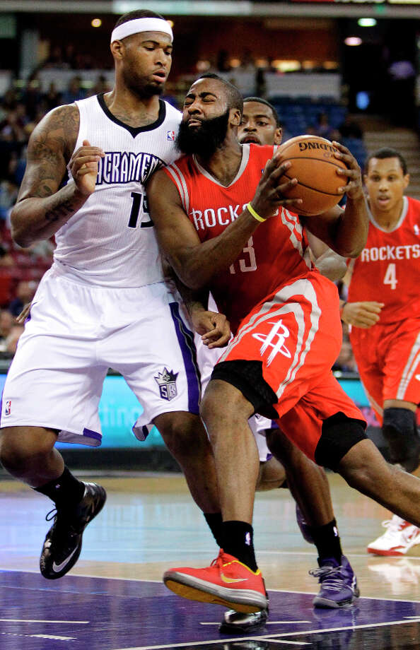 Rockets guard James Harden tries to drive against DeMarcus Cousins of the Kings. Photo: Rich Pedroncelli