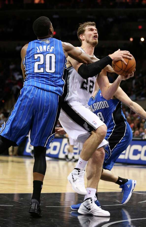 The Spurs\' Tiago Splitter is fouled by Orlando Magic\'s DeQuan Jones during the second half at the AT&T Center, Wednesday, April 3, 3013. The Spurs won 98-84. Photo: Jerry Lara, San Antonio Express-News / ©2013 San Antonio Express-News