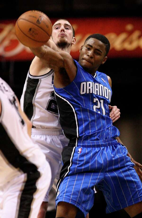 The Spurs\' Nando De Colo is called for a reach in foul against Orlando Magic\'s Maurice Harkless during the second half at the AT&T Center, Wednesday, April 3, 3013. The Spurs won 98-84. Photo: Jerry Lara, San Antonio Express-News / ©2013 San Antonio Express-News