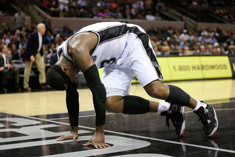 The Spurs\' Stephen Jackson reacts after hurting his right ankle during the first half against the Orlando Magic at the AT&T Center, Wednesday, April 3, 3013. Jackson did return to play the rest of the game. Photo: Jerry Lara, San Antonio Express-News / ©2013 San Antonio Express-News