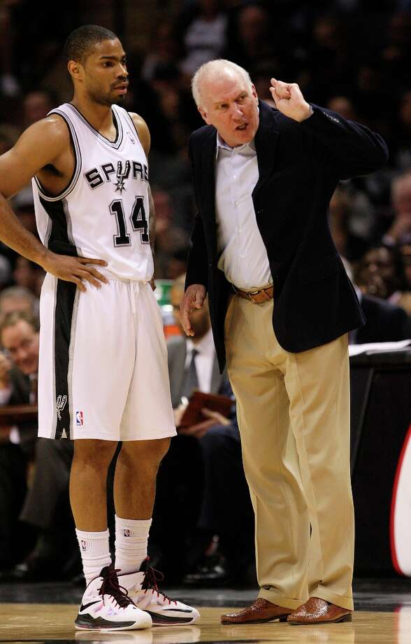 Spurs coach Gregg Popovich talks with Gary Neal during during a break against the Orlando Magic at the AT&T Center, Wednesday, April 3, 3013. The Spurs won 98-84. Photo: Jerry Lara, San Antonio Express-News / ©2013 San Antonio Express-News