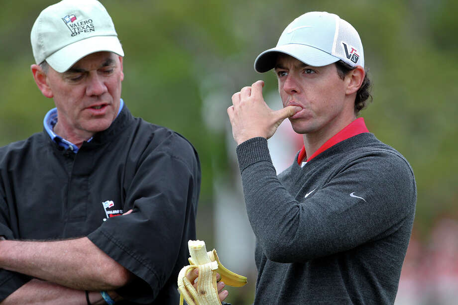 Rory McIlroy grabs some nutrition at the turn as he plays in the pro am tournament at the Valero Texas Open on  April 3, 2013. Photo: TOM REEL, Express-News
